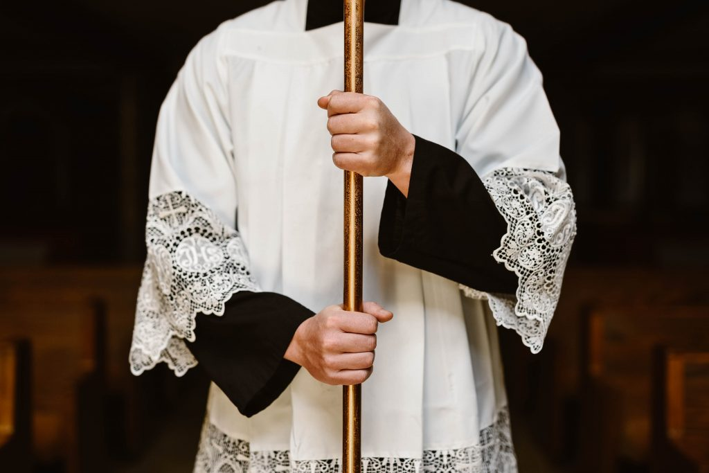 Altar server in cassock and surplus